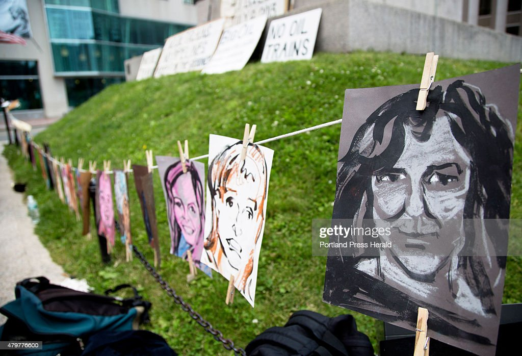 A portrait of Natachat Gaudreau by Lee Chisholm hung on a line during the a vigil held by 350 Maine and Sierra Club Maine for the 47 victims of...