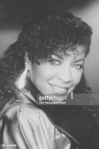 Portrait of Natalie Cole AfricanAmerican singer and songwriter daughter of Nat King Cole smiling looking over her shoulder November 20 1996