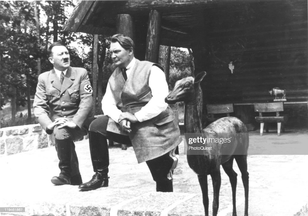 Portrait of Nazi dictator <a gi-track='captionPersonalityLinkClicked' href=/galleries/search?phrase=Adolf+Hitler&family=editorial&specificpeople=90219 ng-click='$event.stopPropagation()'>Adolf Hitler</a> (1889 - 1945) (left) and <a gi-track='captionPersonalityLinkClicked' href=/galleries/search?phrase=Hermann+Goering&family=editorial&specificpeople=93518 ng-click='$event.stopPropagation()'>Hermann Goering</a> (1893 - 1946) as they pose next to a deer sculpture on the porch of the latter's villa, Carinhall, Prussia, July 5. 1937.