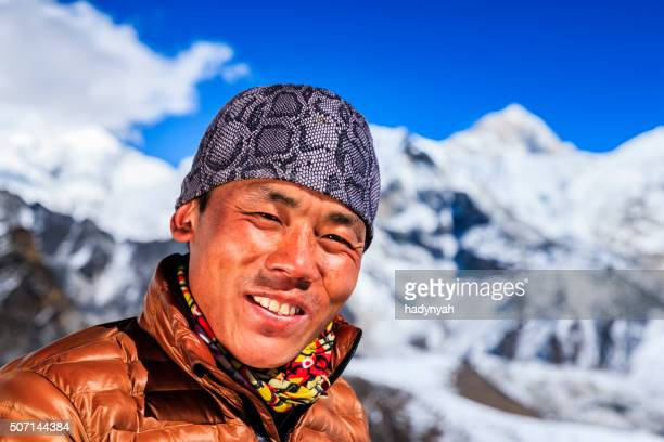 Portrait of Nepali Sherpa, Mount Makalu on background, Nepal
