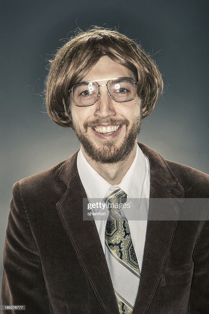 'Portrait of Nerdy Scholar in Corduroy Jacket, Smiling at Camera'