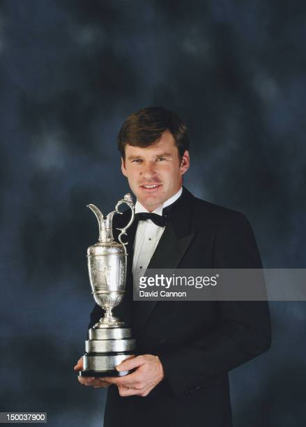 A portrait of Nick Faldo holding the Claret Jug trophy for becoming British Open Champion in 1990 on 1st December 1990 in London England