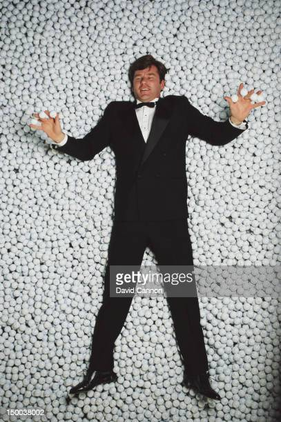 A portrait of Nick Faldo laying amongst thousands of golf balls on 1st December 1990 in London England