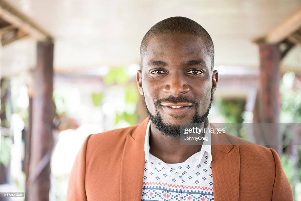 Portrait of Nigerian man with beard looking at camera : Stock Photo