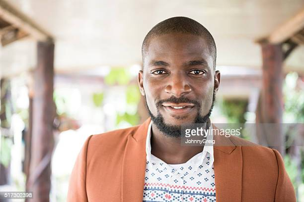 Portrait of Nigerian man with beard looking at camera