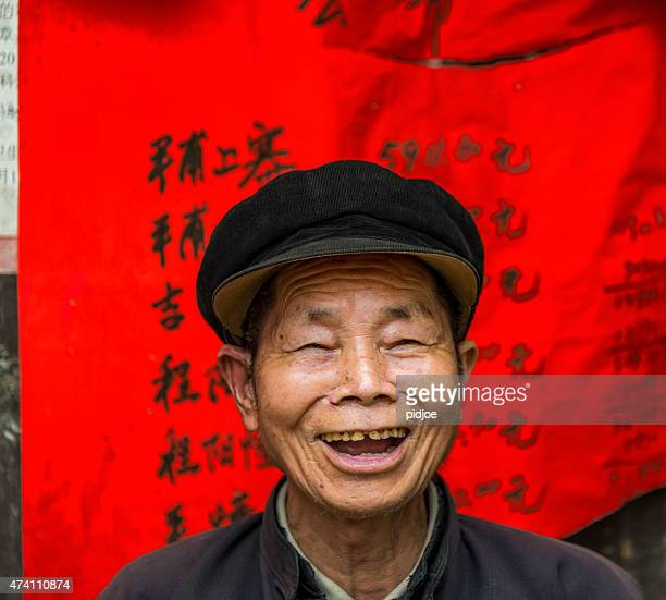 Portrait of old, senior chinese man, laughing