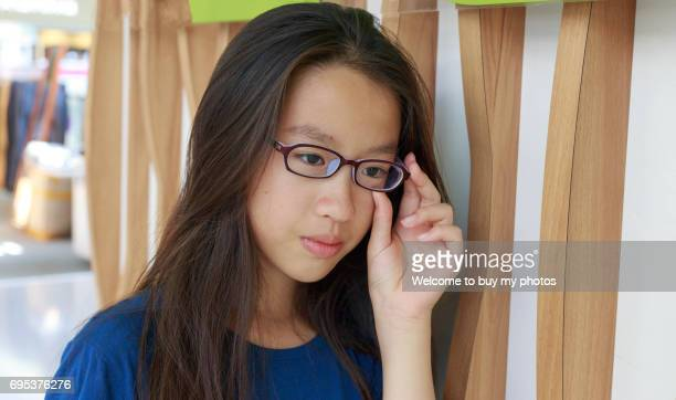 Portrait of one girl who has the myopia problem