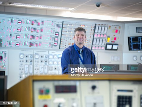 Portrait of operator in nuclear power station control room simulator