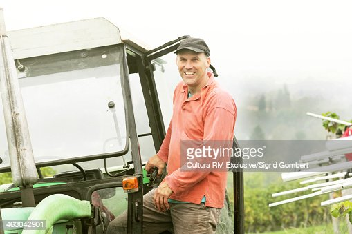 Portrait of organic wine grower by tractor : Stock Photo
