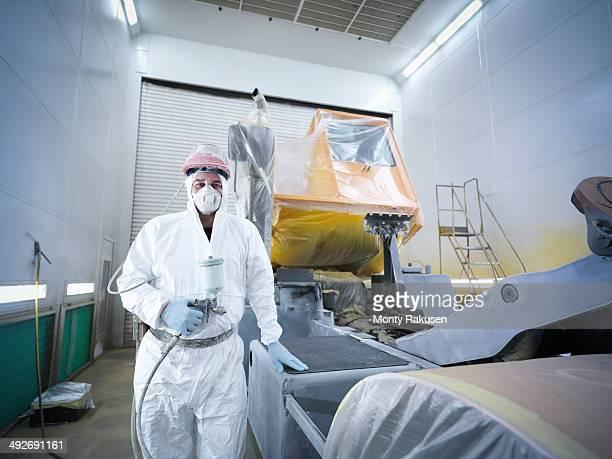 Portrait of paint spray technician in truck repair factory