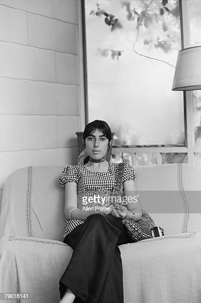 Portrait of Pakistani politician and former Prime Minister Benazir Bhutto as she sits on a couch Greenville Mississippi April 1972 She attended...