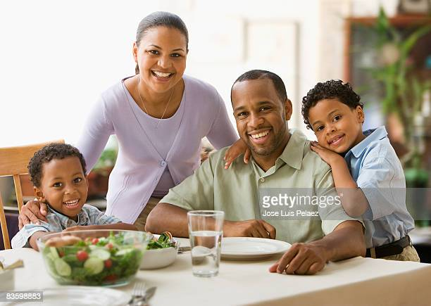 Portrait of parents and 2 sons at the dinner table