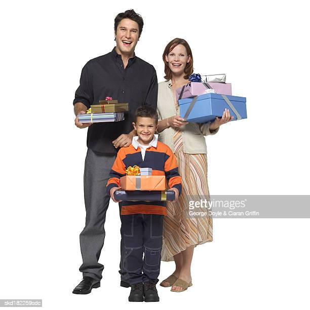 Portrait of parents and son (8-9) holding gifts