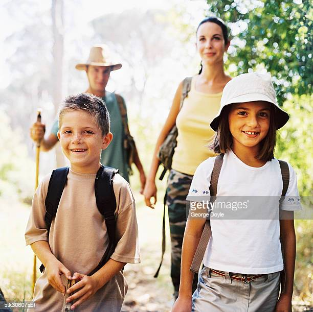 portrait of parents trekking with their son and daughter