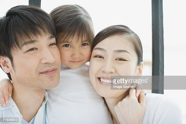 Portrait of parents with their daughter