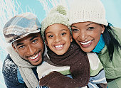 Portrait of Parents With Their Son Wearing Winter Clothing