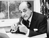 Portrait of Patrick Gordon Walker former Foreign Secretary smoking a pipe at his desk following his return to cabinet London January 9th 1967