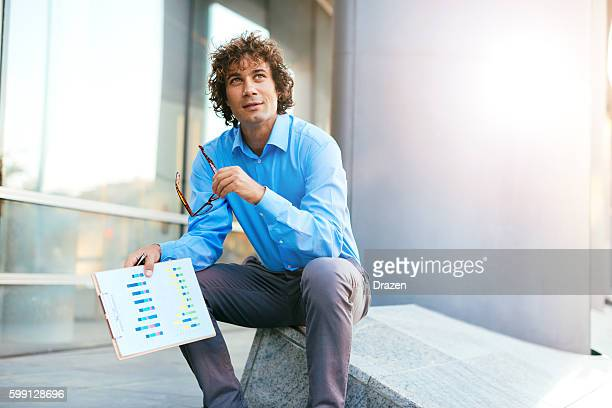 Portrait of pensive businessman dealing with financial markets