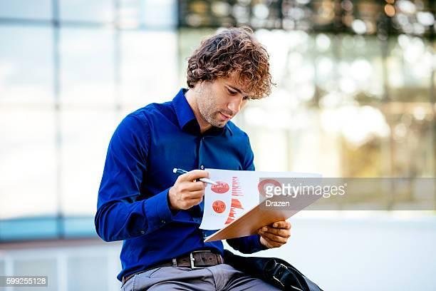 Portrait of pensive businessman dealing with financial markets