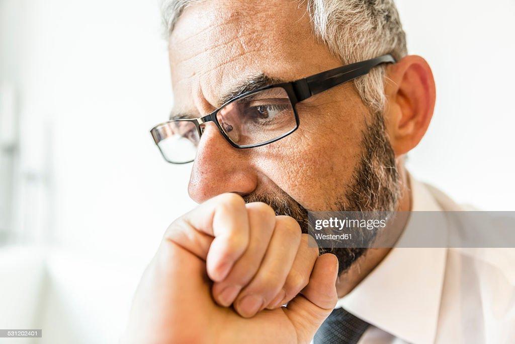 Portrait of pensive businessman