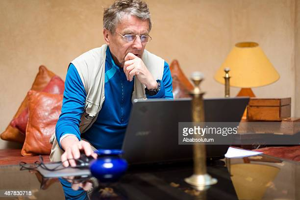 Portrait of Pensive Senior Man Using Laptop, Morocco, Africa
