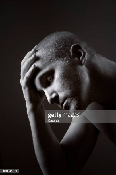 Portrait of Pensive Young Man Resting Head in Hand, Toned
