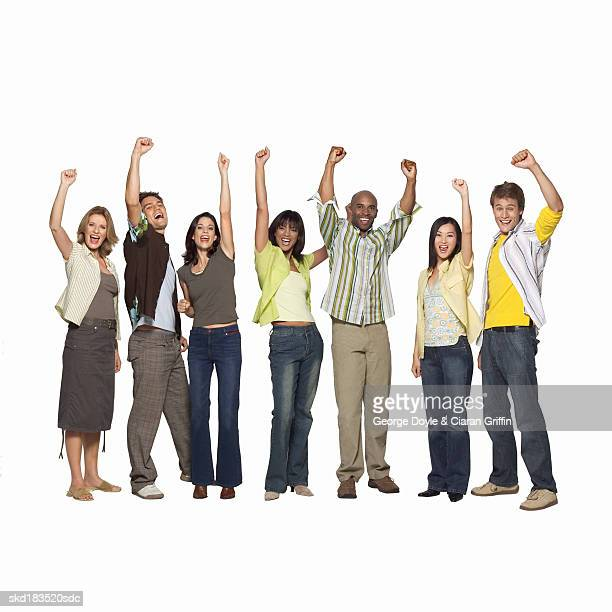 Portrait of people raising their arms in the air