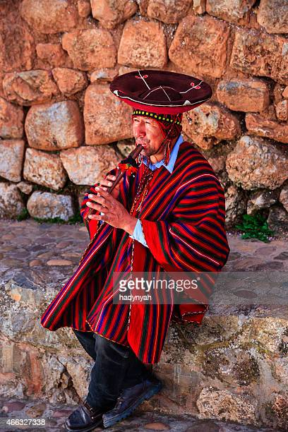 Portrait of Peruvian man playing a flute, Sacred Valley