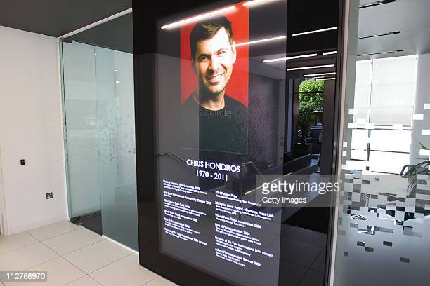 A portrait of photojournalist Chris Hondros is displayed on a large screen in the foyer of the Getty Images London office on April 21 2011 in London...