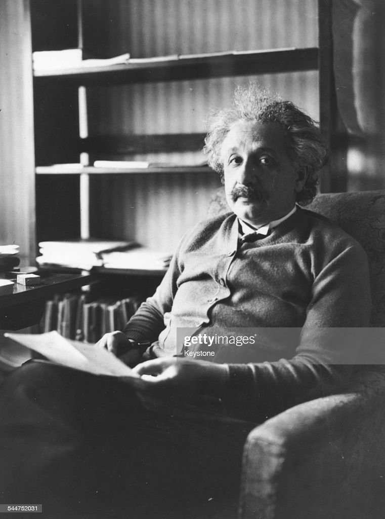 Portrait of physicist <a gi-track='captionPersonalityLinkClicked' href=/galleries/search?phrase=Albert+Einstein&family=editorial&specificpeople=70023 ng-click='$event.stopPropagation()'>Albert Einstein</a> sitting in an armchair and reading, 1929.