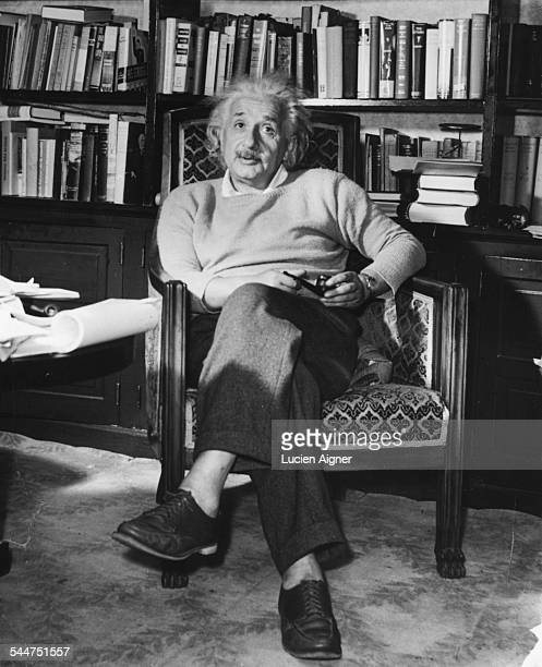 Portrait of physicist Albert Einstein sitting in an armchair with a pipe circa 1934