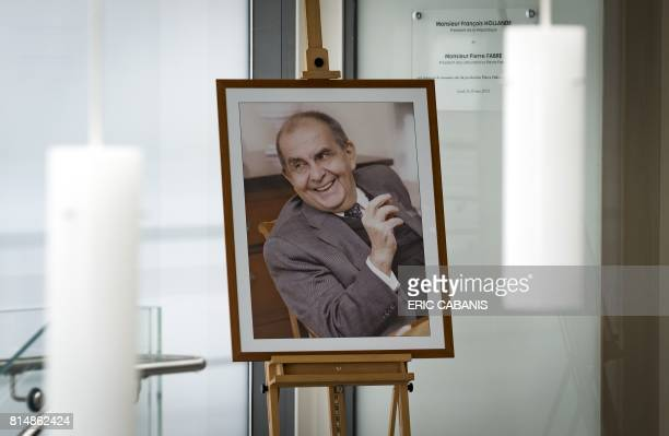 A portrait of Pierre Fabre founder of the French multinational pharmaceutical and cosmetics company 'Pierre Fabre' is displayed at the entrance of...