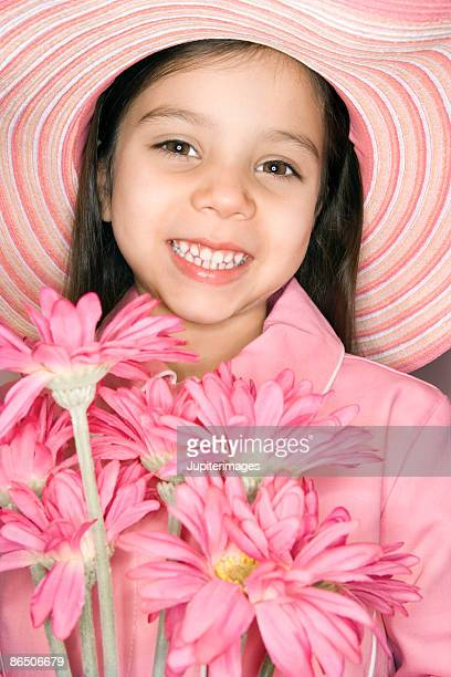 Portrait of pink girl with bouquet