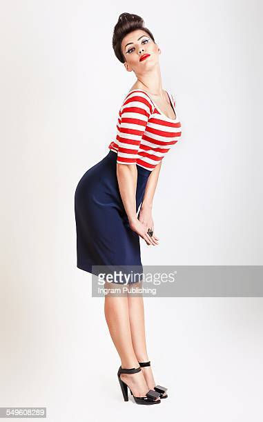 Portrait of pin-up girl in t-shirt and skirt
