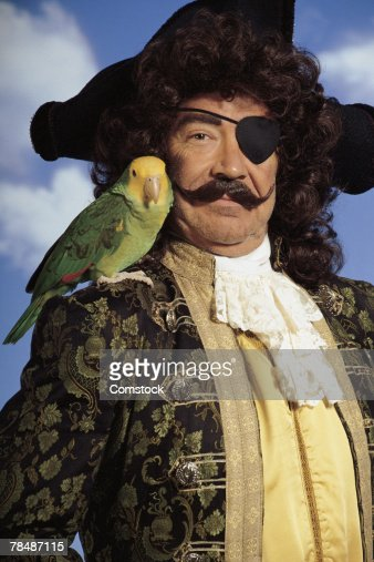 Portrait of pirate with parrot