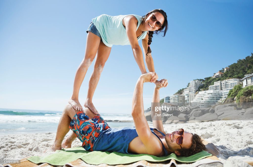 Portrait of playful couple on beach : Stock Photo