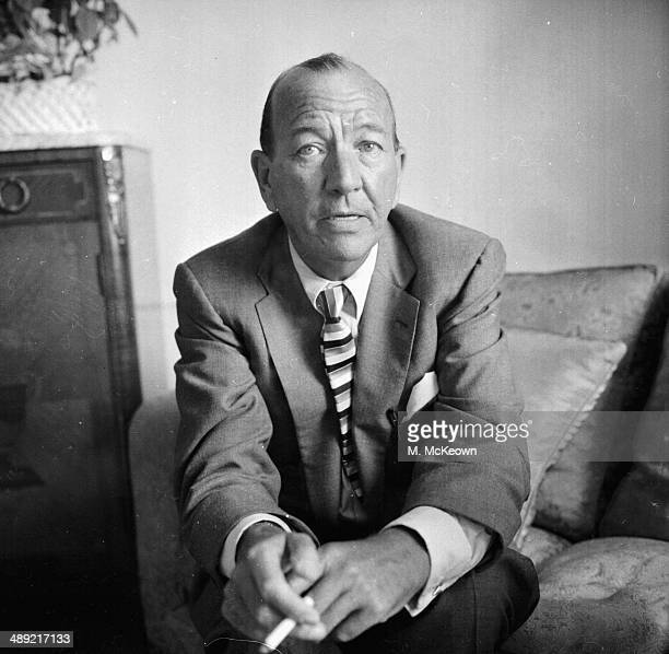 Portrait of playwright and actor Noel Coward smoking a cigarette London July 21st 1958