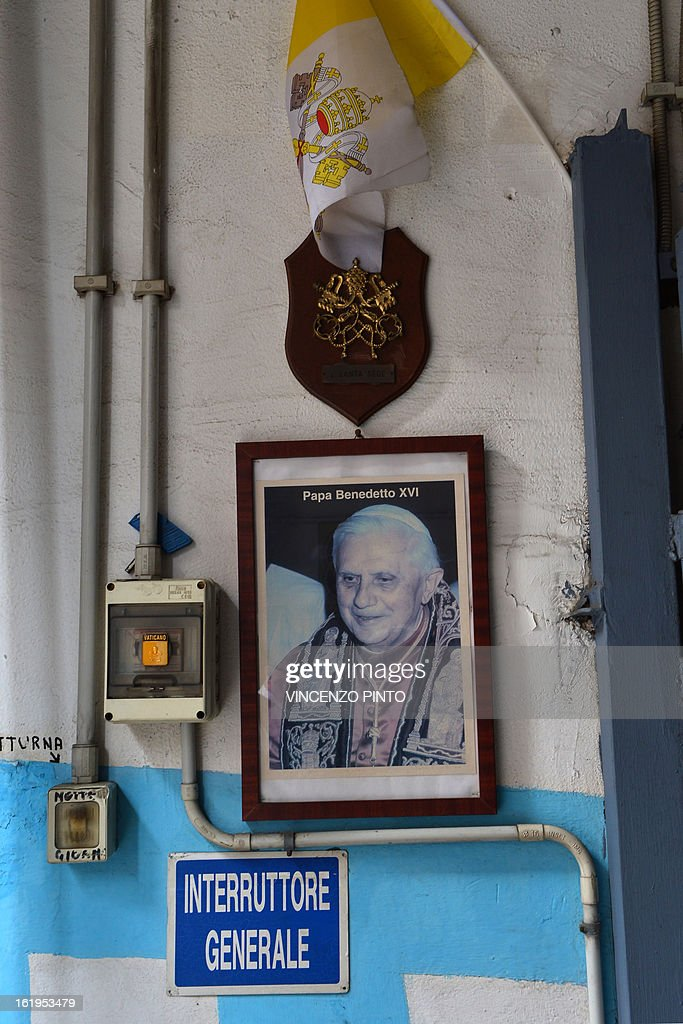 A portrait of Pope Benedict XVI is displayed in a car park near the Vatican on Febraury 18, 2013 in Rome. Pope Benedict XVI began a week-long spiritual retreat out of the public eye on Monday ahead of his resignation on February 28, with the field of candidates to succeed him still wide open. AFP PHOTO / VINCENZO PINTO