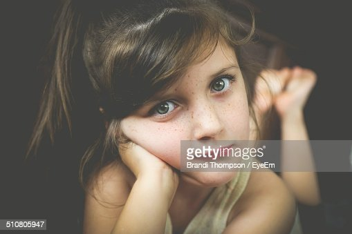 Portrait of preadolescent girl lying at home