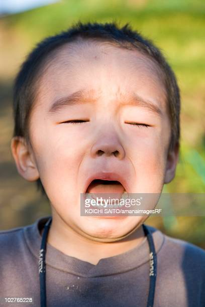 Portrait of preschool age boy crying