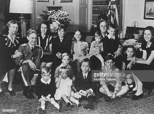 Portrait of President Franklin D Roosevelt and Eleanor Roosevelt with their many grandchildren Christopher Anna Sturgis John Boettiger and Haven...