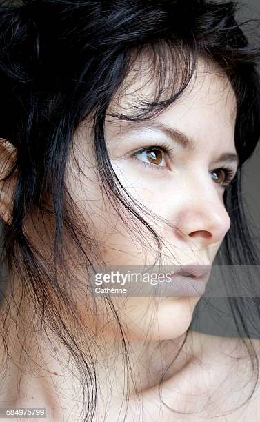 Portrait of pretty female with dark hair
