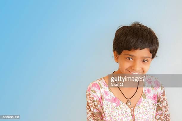 Portrait of pretty pre-teenage Asian girl with copyspace.