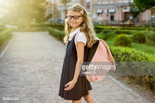 Portrait of pretty student on the way to school : Stock Photo