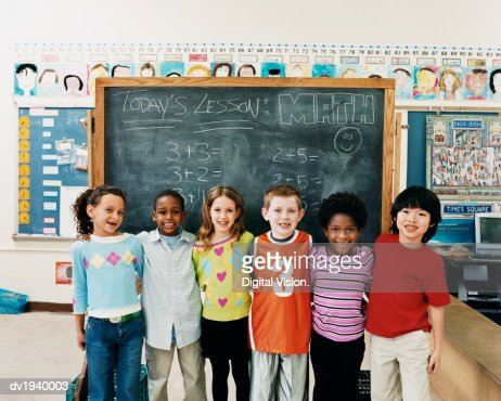 Portrait of Primary Schoolboys and Schoolgirls Standing in a Line in a Classroom : Stock-Foto