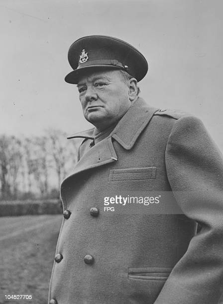 A portrait of Prime Minister Winston Churchill visits a Scottish armoured unit fighting with the 1st Canadian Army during World War II circa 1940s