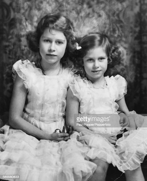 Portrait of Princess Elizabeth and Princess Margaret posed together in 1936