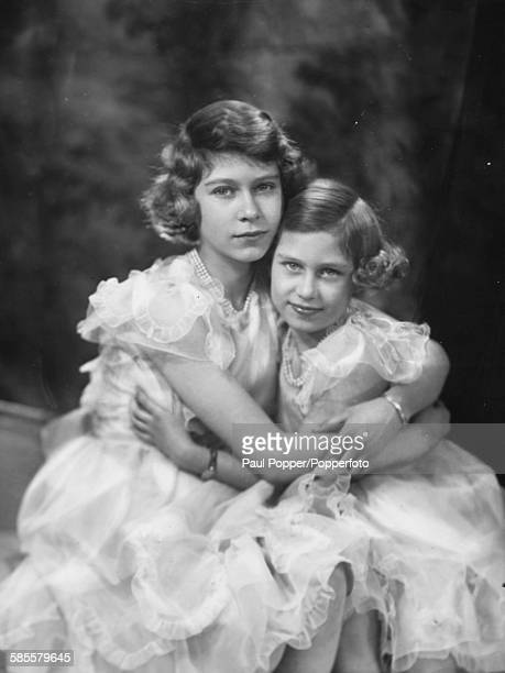 Portrait of Princess Elizabeth and Princess Margaret with their arms around each other 1939