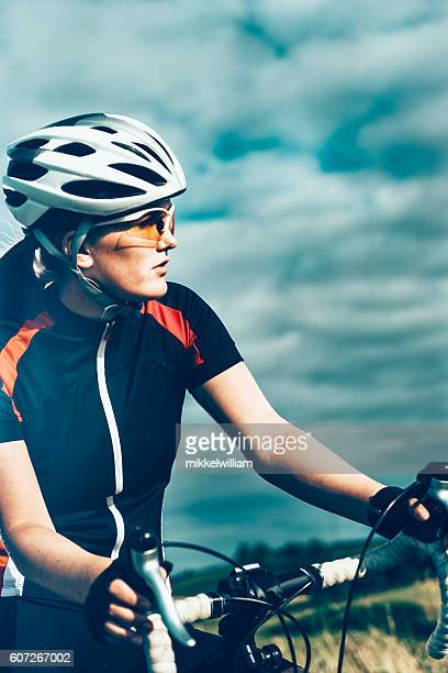 Portrait of professional female bike rider on the move