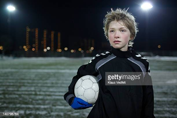 Portrait of proud boy with football (soccer)